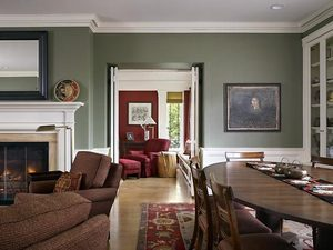 Interior designer Virginia Stamey helped select furniture and carpets. Steve Romein chose the warm, comfortable color palette of sage green and deep reds and yellows that runs through the freshly painted, light-filled rooms of the old house.