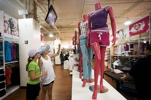 Abbie and Nicole Grinager of Sioux Falls, S.D., shop at Steve & Barry's clothing store in New York. On Wednesday the company, which operates five stores in Washington, announced it filed for bankruptcy protection.