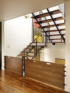 The stairwell openings are so generous, the couple had Dyna Contracting build custom baby gates.