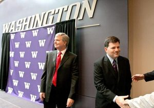 Scott Woodward, right, shakes hands after a news conference Wednesday where University of Washington President Mark Emmert, left, named Woodward the new UW athletic director.