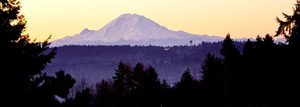 Mt. Rainier glistens in the early morning sunrise in this view from the Horizon View neighborhood of Lake Forest Park.