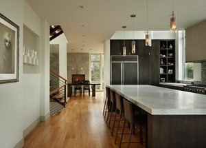 The large, open kitchen features a marble-topped island, 4 feet by 12 feet. The cabinets are dark-stained, rift-sawn red oak.