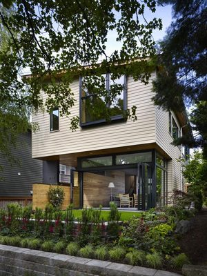 Wall House on Queen Anne is contemporary, but it relates to its traditional neighbors in scale and material. The shed roof slopes as a transition between the multifamily housing to one side and the single family home on the other. The home is built on the previous foundation, and the original structure was deconstructed so the materials could be resued.