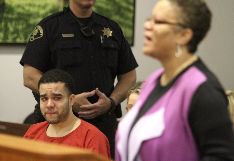 Daniel Threadgill, left, looks toward his mother, Marsha Richardson, during his sentencing hearing in King County Superior Court Judge Cheryl Carey's courtroom Wednesday. Threadgill got an exceptional sentence of 40 years for killing Jennifer Walstrand.