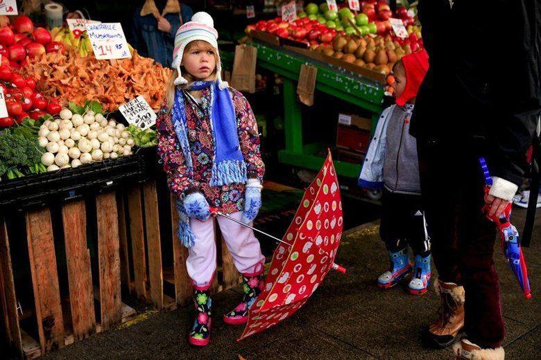Maeve Urban, 6, walks through Pike Place Market on Sunday with her family, of Vancouver, B.C. It sprinkled throughout the day. Heavier rain is expected this week.