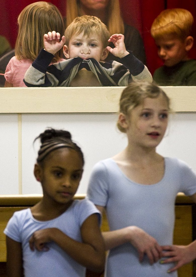 Wyatt Olson, 3, looks in on his eight-year-old sister Aspen's (tallest) ballet class at American Dance Institute in Greenwood Tuesday, Dec. 4, 2012.  Standing next to Aspen is Nia Williamson, 7. The class, Children's Ballet I, is taught by Kelsey Hamon, who has been teaching there for about eight years. The American Dance Institute has classes for all ages, and is celebrating its 25th anniversary in the new year. The American Dance Institute will be performing during the Greenwood-Phinney Art Walk Friday, Dec. 14, from 7-9 p.m. Students of all ages will showcase styles as diverse as ballet, flamenco, hula, tap, Irish step, modern and jazz, seen from the large window of Studio 1 on Greenwood Avenue and North 80th Street.