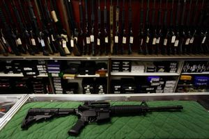 A Bush Master AR-15 assault rifle is displayed at a gun shop in Aurora, Colo., not far from the theater where  James E. Holmes  is accused of killing 12 people in July.