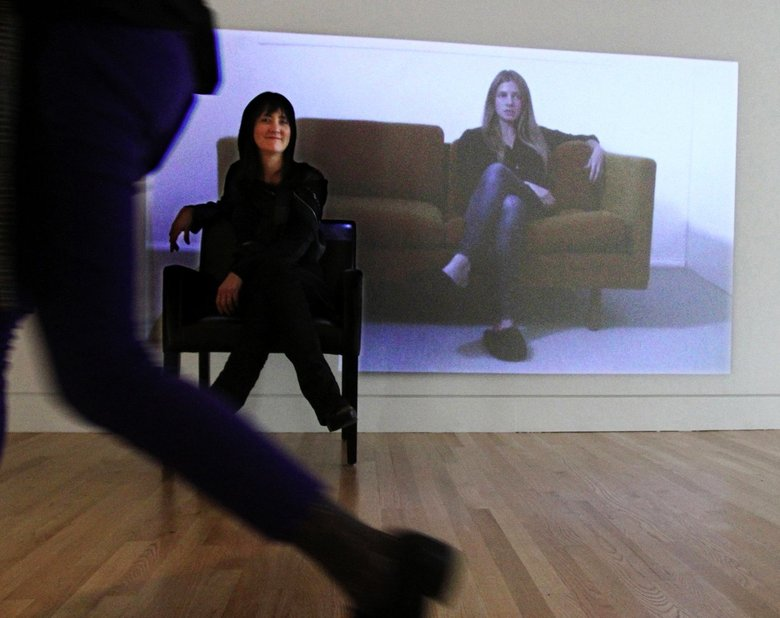 "Freelance visual-arts curator Yoko Ott helped with the Frye Art Museum's new show, ""Mw [Moment Magnitude]"" and one of her favorite pieces is this video by Anne Fenton singing ""Success,"" seated on a couch."