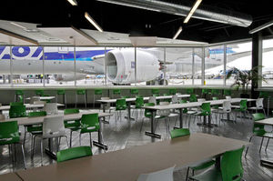 The center's first-floor cafeteria has sweeping windows that look out at the aircraft about to be delivered.