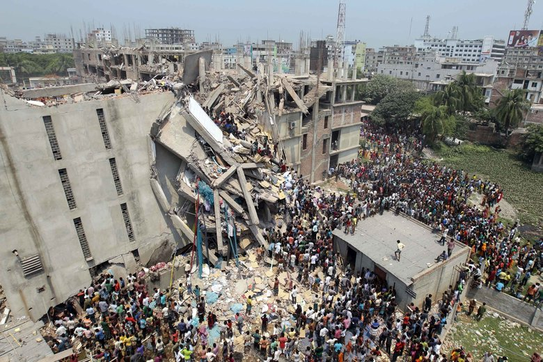 People and rescuers gather after an eight-story building housing several garment factories collapsed in Savar, near Dhaka, Bangladesh, Wednesday.