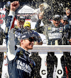 Driver Kasey Kahne of Enumclaw celebrates in victory lane Sunday at Pocono Raceway in Long Pond, Pa.
