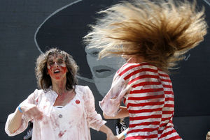 Saturday's Zombie Run, and the Red, White and Dead Zombie Block Party in Fremont, shown above, attest to the popularity of the undead in pop culture.