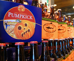A display features pumpkin beers for sale in August at a Whole Foods Market in Richmond, Va.