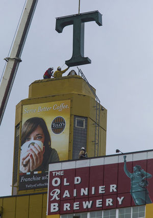 """The """"T"""" for Tully's comes down Monday from its perch next to Interstate 5 in Seattle."""