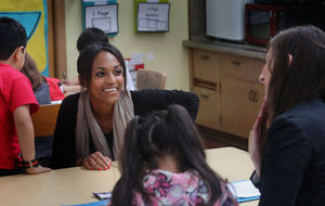 Ariana Westbrook smiles at Julie Solarek, right, during a brief moment between helping students at Olympic Hills Elementary in Seattle. Solarek, a mentor teacher, is working this school year with Westbrook, who is an apprentice in the new Seattle Teacher Residency.