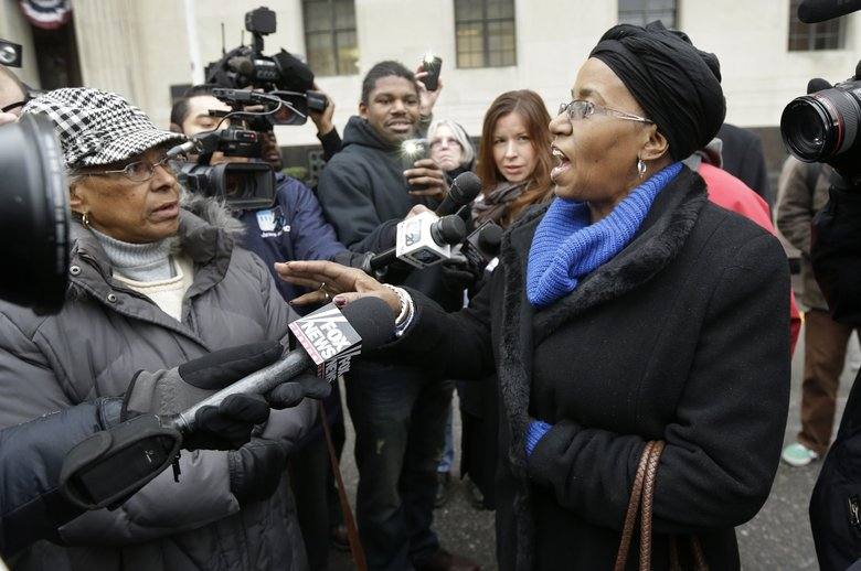 Retiree Cecily McClellan talks to the media outside the federal courthouse in Detroit, Tuesday, after Judge Steven Rhodes ruled on the city's bankruptcy filing. Judge Rhodes turned down objections from unions, pension funds and retirees, which, like other creditors, could lose under any plan to solve $18 billion in long-term liabilities.