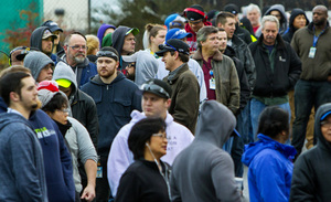 Machinists wait in line early Friday morning to vote at the Everett union hall, across the street from the Boeing final assembly plant.<br/>