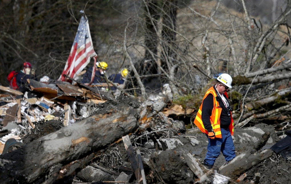Safety manager Mike Breysse of WSDOT walks in the wreckage and debris near mile marker 37 on Highway 530, on Monday, March 24, 2014.