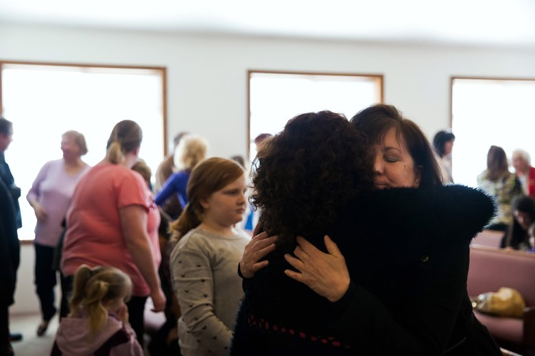 The congregation of Glad Tidings Assembly of God greet each other and hug one another during church service in Darrington, on Sunday, March 30, 2014.
