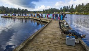 The Cottage Lake  pier was a popular spot on the opening day of lowland lakes trout fishing, and most anglers had success.