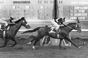 Trooper Seven, ridden by Gary Baze, has a 1-length lead over Reb's Golden Ale at the finish of Longacres Mile in August 1981.