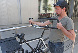 Clement Gallois, with local design firm Teague, with a new bicycle he helped design. The handle bar comes off and becomes a bike lock.