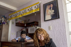 Lorena Serrano and son Luis Daniel Vargas, 13, live flanked by abandoned houses in Zumpango, Mexico. Her husband works in Mexico City and returns on weekends.