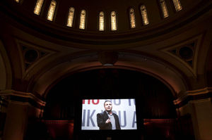 Founding pastor Mark Driscoll gives a video sermon at the grand opening of Mars Hill Downtown Seattle in the former First United Methodist Church. The service marked the rebirth of one of the city's oldest church buildings — the place where pioneer Seattle families including the Dennys, the Bells and the Borens worshipped.
