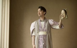 Munenori Takeda holds the mask he will wear. In one performance he plays a 12th-century female warrior. Most Noh characters are played by males.
