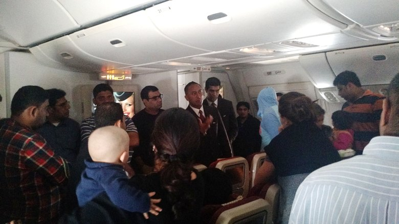This photo provided by Rithvik Reddy shows passengers aboard  Etihad Airways Flight EY 183 who where stuck on the tarmac for 12 hours. Hundreds of air travelers landed in San Francisco, Sunday safe but irritated after a 28-hour overseas flight they say included 12 hours on a tarmac in the Middle East without food or accurate flight information.