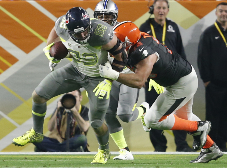 Team Carter DE J.J. Watt from the Texans returns an interception while tackled by Team Irvin tackle Joe Thomas of the Cleveland Browns during the Pro Bowl at University of Phoenix Stadium in Glendale, Ariz., Sunday, Jan. 25, 2015, Ariz.  (AP Photo/The Arizona Republic, Michael Chow)
