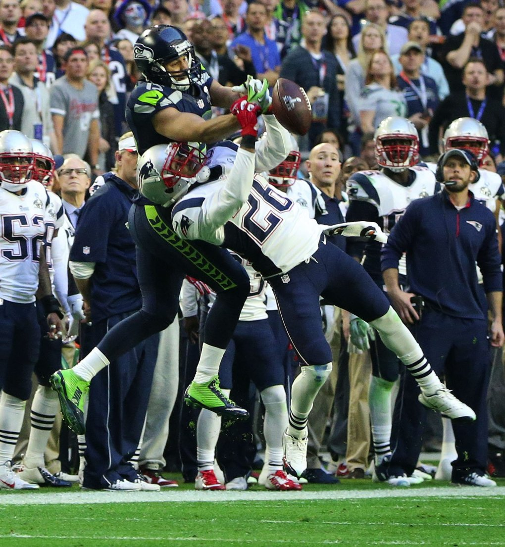 Seahawks wide receiver Jermaine Kearse can't pull in a pass from Seahawks quarterback Russell Wilson while being defended by Patriots corner back Logan Ryan during the second quarter. (Bettina Hansen / The Seattle Times)