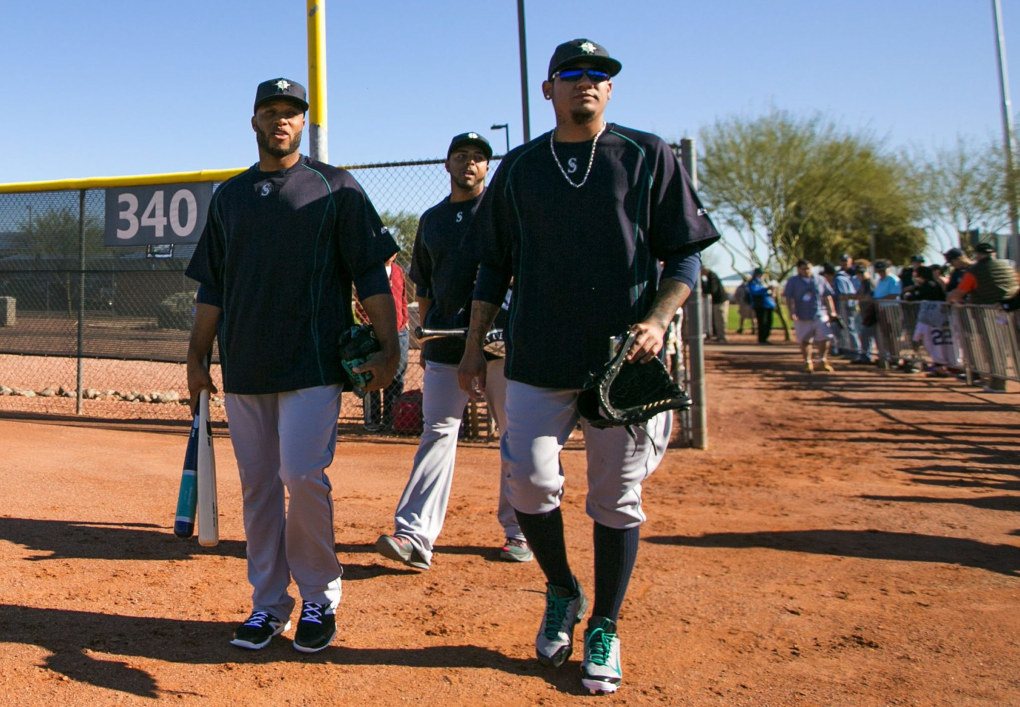 Mariners second baseman Robinson Cano, left fielder Nelson Cruz and pitcher Felix Hernandez walk in for Spring  on Wednesday. (Bettina Hansen / The Seattle Times)