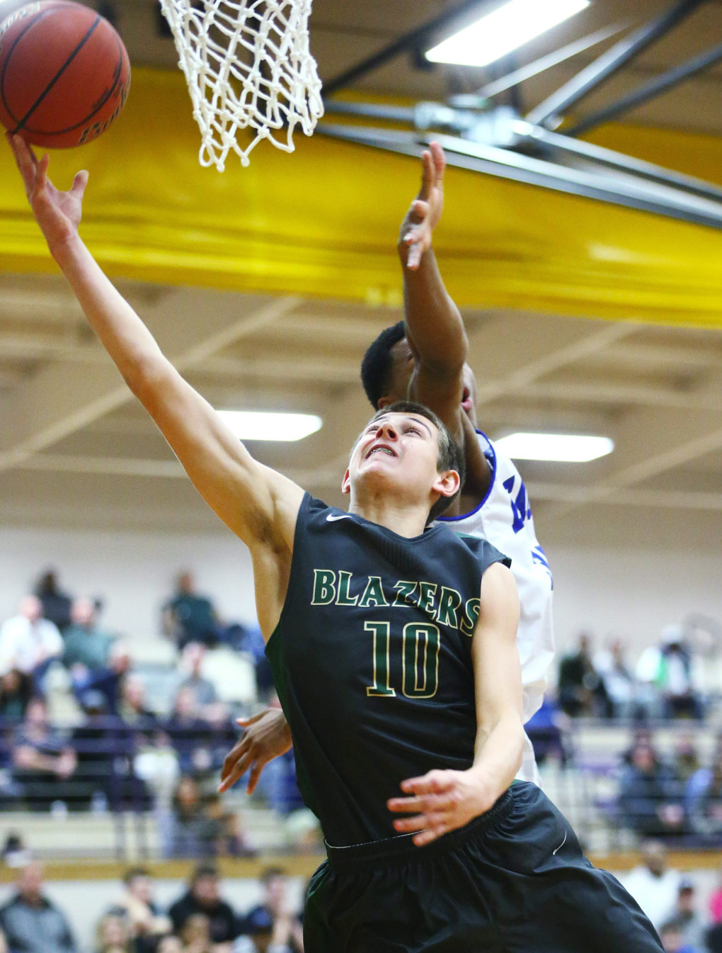 Timberline shooting guard Erik Stevenson goes in for a shot against Federal Way center Timoney Buckley during the first half of the Boys 4A Hardwood Classic regional round at Puyallup High School on Friday, Feb. 27, 2015.  (Lindsey Wasson / The Seattle Times)