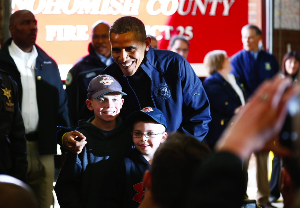 President Obama poses with Landon Harper, 9, left, and his brother Levi, 7, sons of Oso Fire Chief Willy Harper, as their mom, Michelle, takes a photo at the Oso fire station on Tuesday, April 22, 2014. (Lindsey Wasson / The Seattle Times)