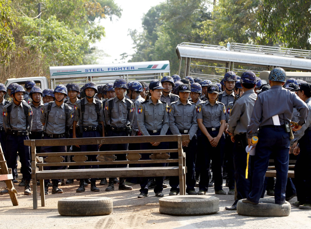 Police block a road leading to the protest camp in Letpadan, Bago division, Myanmar, March 2, 2015. Students from universities across Myanmar are protesting against a 'National Education Bill' which is due to be passed by the parliament. The students have pledged to continue the protest marches until they get solutions for the 11-points they demand from the quadripartite talks.  EPA/NYEIN CHAN NAING