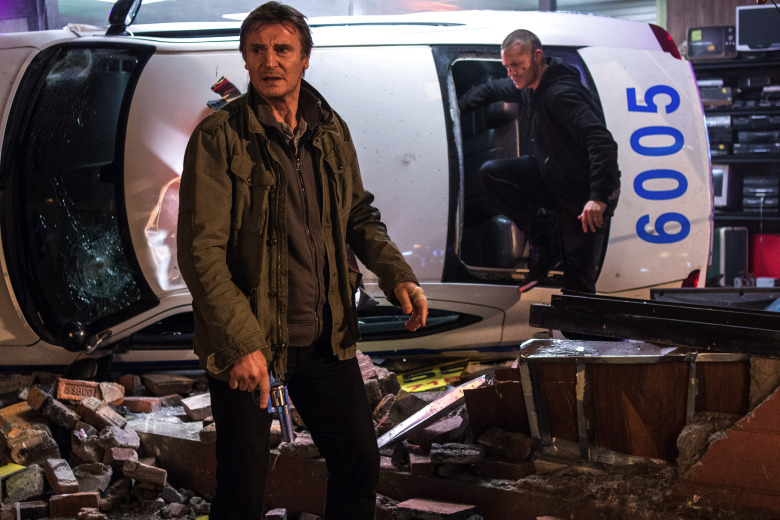 """Liam Neeson, left, stars as a father trying to protect his son (Joel Kinnaman) in """"Run All Night.""""  (Myles Aronowitz)"""