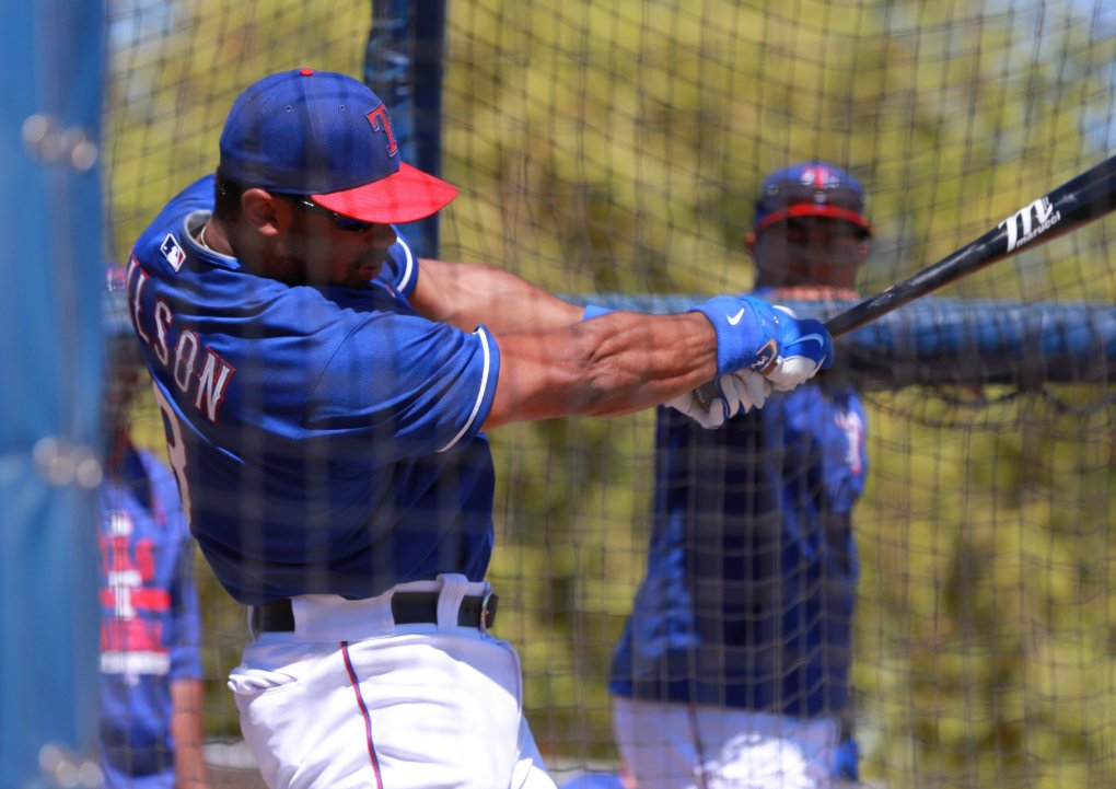 Seahawks quarterback Russell Wilson works out with the Texas Rangers for Spring Training in Surprise, Arizona. (Bettina Hansen / The Seattle Times)