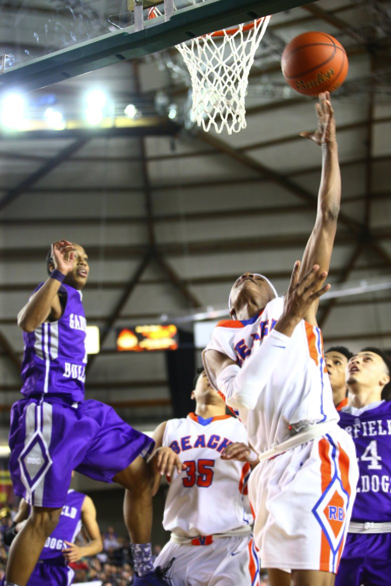 Rainier Beach guard Shadeed Shabazz tries to put in a shot as he sails off the court in the first half of the Hardwood Classic 3A Boys Final at the Tacoma Dome on Saturday, March 7, 2015. (LINDSEY WASSON/THE SEATTLE TIMES)