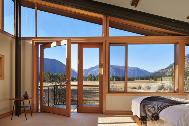 """He's even got the bed at a level you feel like you're sleeping outdoors,"" says homeowner Jeff of the siting of the master bedroom. Outside is a view that reminds the couple of the place they grew up, Montana. (Benjamin Benschneider / The Seattle Times)"