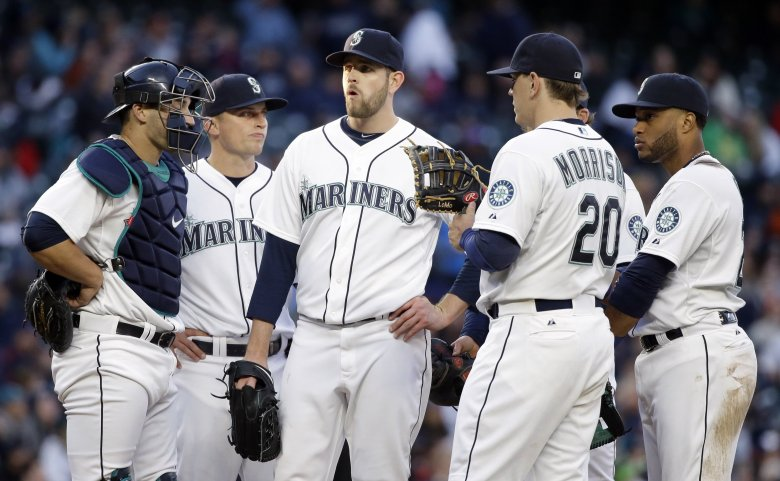 Seattle Mariners starting pitcher James Paxton, center, waits with teammates on the mound before being relieved in the fifth inning of a baseball game against the Minnesota Twins, Saturday, April 25, 2015, in Seattle. (AP Photo/Elaine Thompson) WAET110 — 0433211623 (Elaine Thompson/The Associated Press)