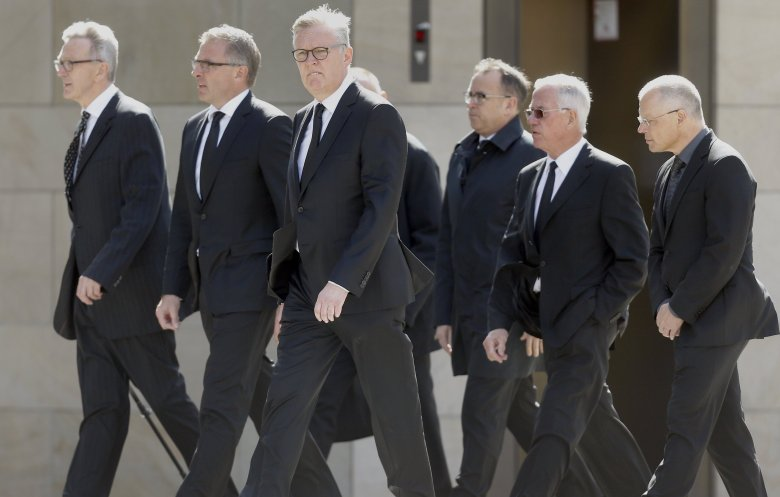 Lufthansa CEO Carsten Spohr, second left, and Germanwings CEO Thomas Winkelmann, third left, arrive at the Cologne Cathedral in Cologne, Germany, Friday, April 17, 2015. A mourning ceremony will be held in the Cathedral  in memory of the 150 victims of the Germanwings plane crash last month in the French Alps.(AP Photo/Frank Augstein)  FAS106