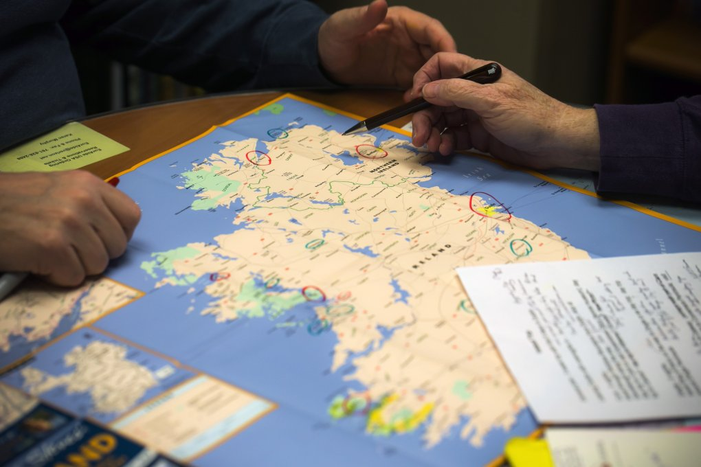A travel consultant and a prospective traveler go over an Ireland itinerary at the Rick Steves Travel Center in Edmonds.  (Bettina Hansen/The Seattle Times)