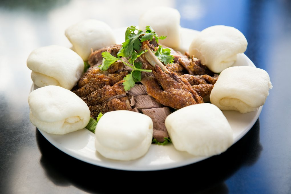 """Fragrant Duck,"" served with steamed buns, is a Wild Ginger classic.  (Marcus Yam / The Seattle Times)"