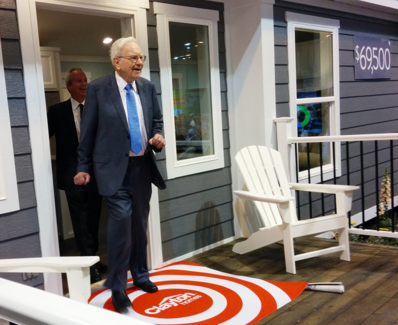 Warren Buffett and Clayton Homes CEO Kevin Clayton walk out of a Clayton mobile home before the Berkshire Hathaway shareholder meeting in Nebraska earlier this month. (Mike Baker / The Seattle Times)