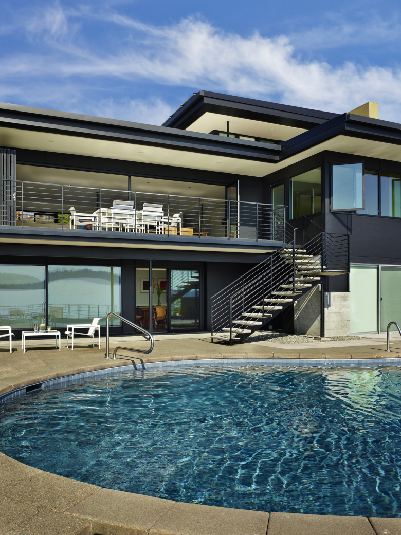 The pool is original to the home. The waterside deck (to both pool and Lake Washington) is new. (Benjamin Benschneider/ The Seattle Times)