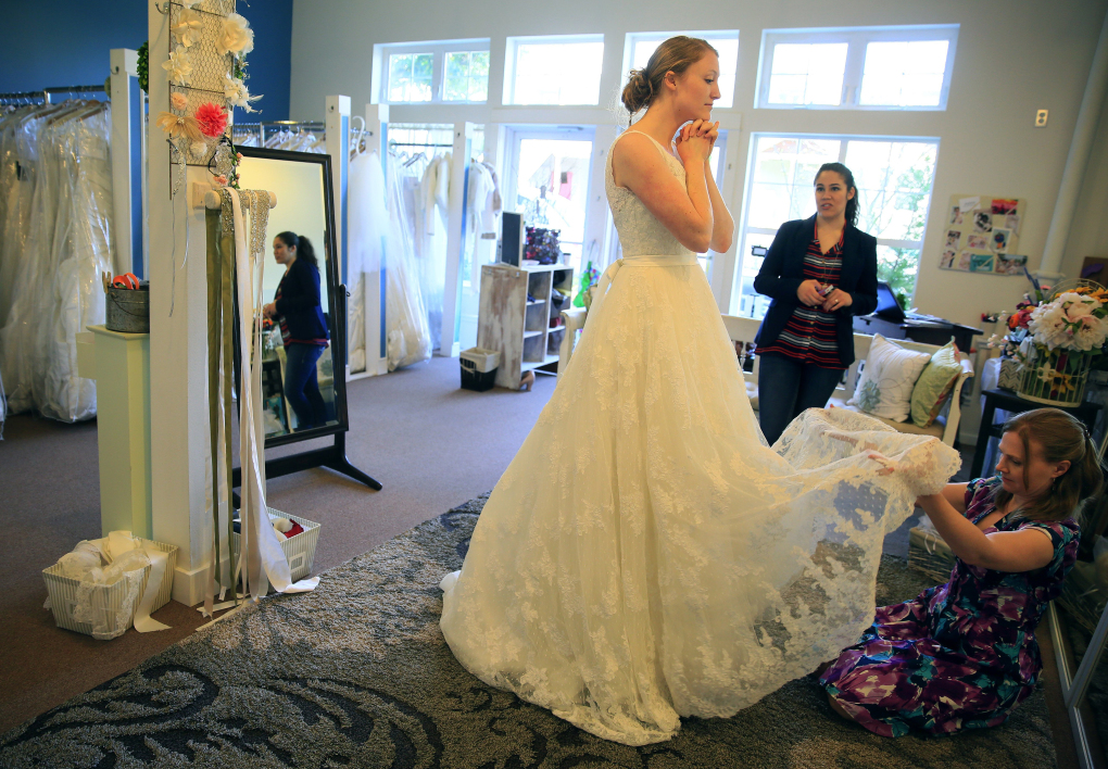 Growing number of brides say yes to a consignment wedding dress ...