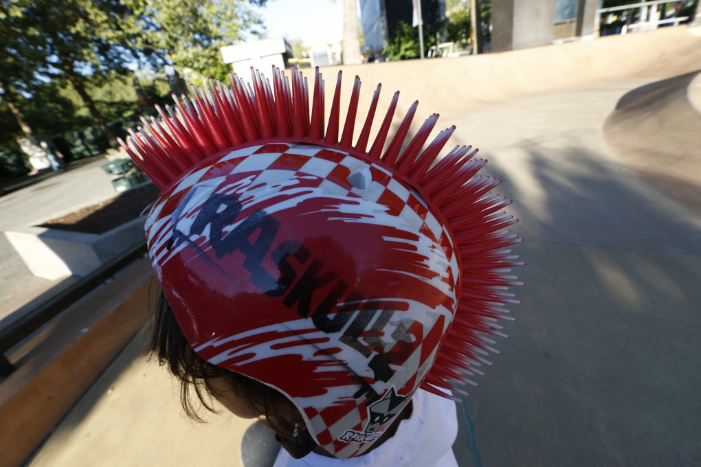 Besides safety, this helmet makes a fashion statement at the park in Seattle Center. (Alan Berner / The Seattle Times)