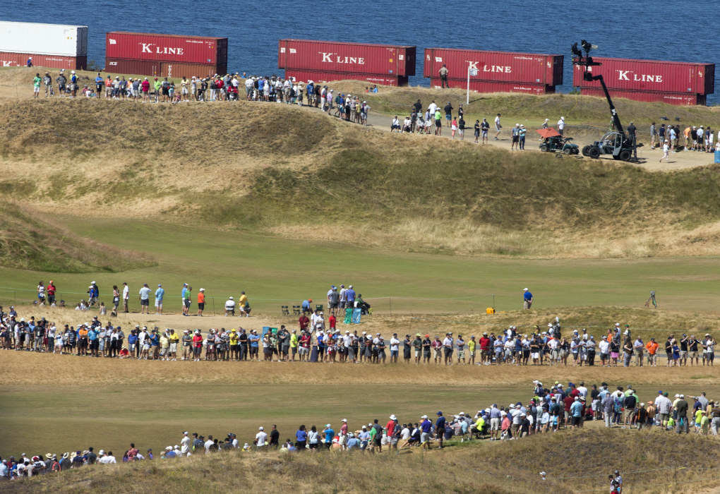 A train passes by the course during the third round of the U.S. Open golf tournament at Chambers Bay.  (Ellen M. Banner / The Seattle Times)