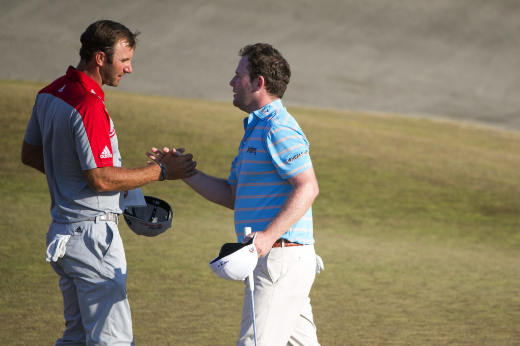 Dustin Johnson and Branden Grace shake hands after the 18th hole for the third round of the U.S. Open golf tournament at Chambers Bay in University Place.   (Bettina Hansen / The Seattle Times)